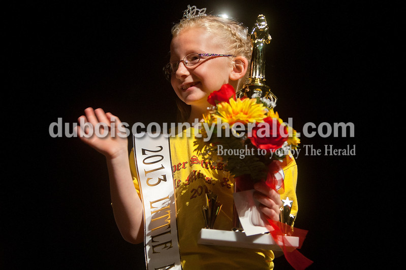 The newly crowned 2013 Little Miss Strassenfest Serenidy Eckerle waived to the crowd in the Jasper Middle School auditorium on Saturday afternoon. Dave Weatherwax/The Herald
