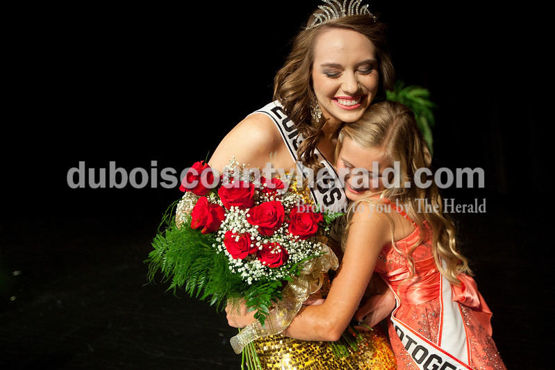 After winning the Miss Strassenfest Queen Pageant on Saturday evening at Jasper Middle School, Mallory Humbert of Jasper, 19, left, hugged Hannah Welp of Jasper, 13. Hannah was named Junior Miss Photogenic during the Junior Miss Strassenfest portion of the contest.  Dave Weatherwax/The Herald
