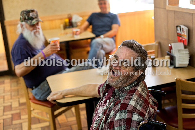 Dave Weatherwax/The Herald<br /> Leaving his Huntingburg apartment just about every morning to have breakfast at Dairy Queen is an important escape said Randy Mullen, who is largely confined to his apartment due to both of his legs being amputated. Mullen joked around with some of the restaurant's employees during his visit last Thursday morning.