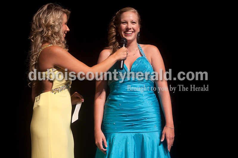 Allie Beckman of Jasper, left, held the microphone for Miss Strassenfest contestant Kimberly Gootee of Jasper, 20, during the interview  portion of the pageant at Jasper Middle School on Saturday. Dave Weatherwax/The Herald