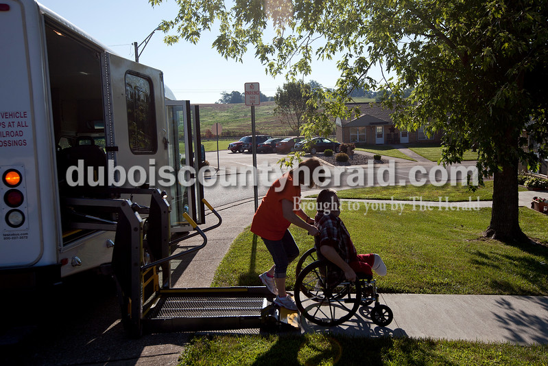 Dave Weatherwax/The Herald<br /> Margie Cooper, a driver for the City of Huntingburg transit, left, wheeled Randy Mullen onto the ramp to load him onto the bus to take him for his morning breakfast last Thursday at Dairy Queen in Huntingburg. Mullen relies on the transit program to get him to the restaurant six days a week. On Sunday, Mullen's friend Wilfred Bohnert of Huntingburg wheels him to the restaurant.
