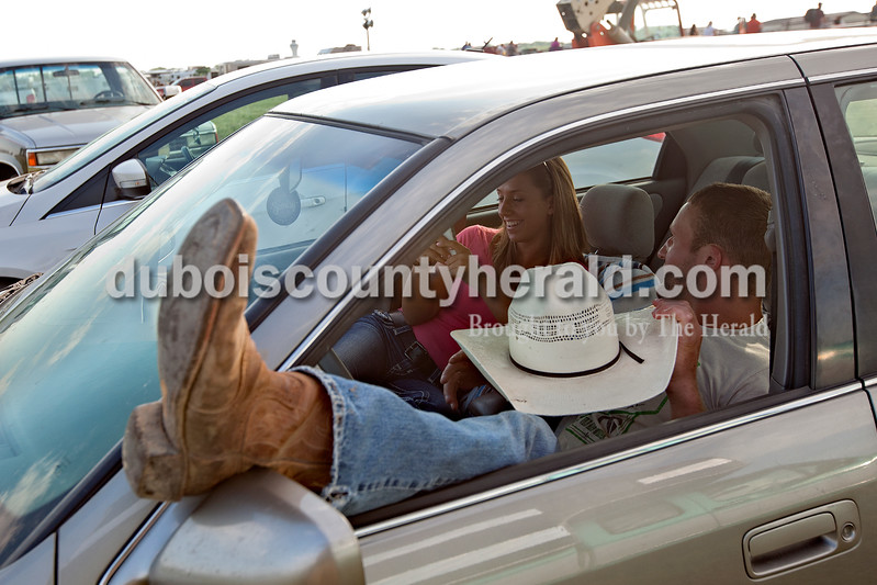 Having arrived a couple hours before the rodeo began near Belleville, Ill., on June 8, Leistner killed time with his girlfriend, Ashley Crosby of Washington, in his car. Dave Weatherwax/The Herald