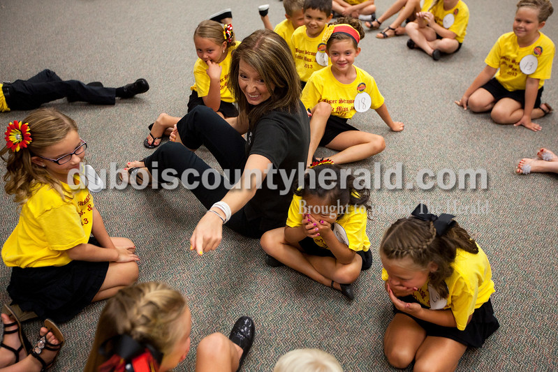 Corie Eckerle of Jasper played a game with the Little Miss and Mister Strassenfest contestants as they waited for the judges to select a winner during the contest Saturday afternoon at Jasper Middle School. Dave Weatherwax/The Herald