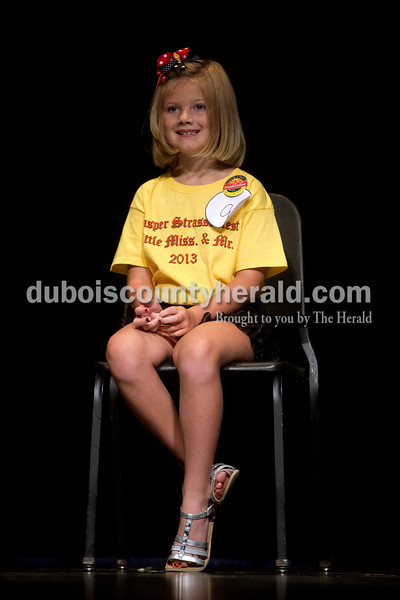 Little Miss Strassenfest contestant Makenzie Shields of Jasper, 8, wore a big grin on her face as she waited onstage for her turn to answer interview questions during the contest Saturday afternoon in the Jasper Middle School auditorium. Dave Weatherwax/The Herald
