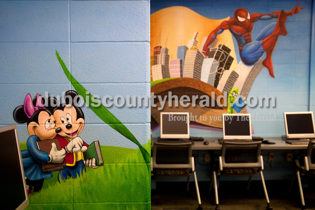 Ariana van den Akker/The Herald<br /> Minnie and Mickey Mouse appeared to walk through a field while Spiderman flew through the air in a new mural in the library at Southridge Middle School on Friday.  The school commissioned the mural, which covers the walls and part of the ceiling, from Orange Moon Art Studio, comprised of Michael and Amanda Smith.  The mural represented the imaginative process that comes from reading.