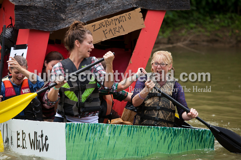 Ariana van den Akker/The Herald<br /> Holy Family teachers Kristi Wehr, left, Jenna Hochmeister and Shelley Weinzapfel, all of Jasper, reacted to their boat starting to collapse and sink during the Holy Family School Cardboard Boat Regatta in Jasper on Saturday.