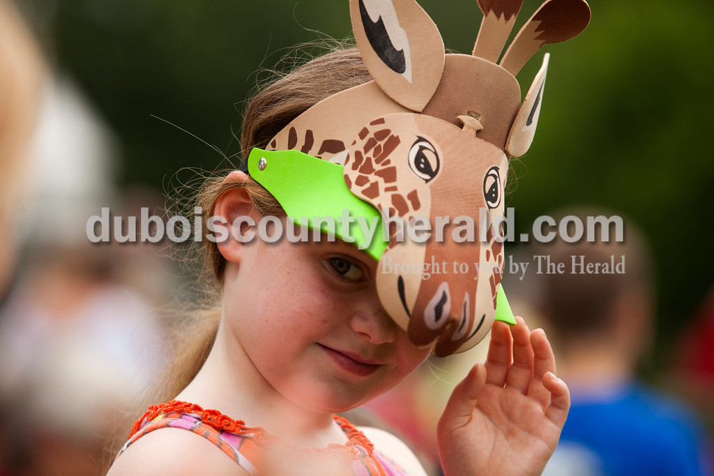 Ariana van den Akker/The Herald<br /> Lily Hulsman of Jasper, 7, donned a giraffe hat to support Trinity United Church of Christ's Noah's Ark-themed boat during the Holy Family School Cardboard Boat Regatta in Jasper on Saturday.