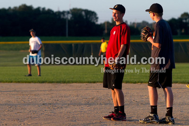 Ariana van den Akker/The Herald<br /> Tanner Egbert, 15, left, and Adam Hedinger, 14, both of Jasper, joked around while waiting for balls during batting practice on Wednesday at the Jasper Babe Ruth team's last practice at the Youth Sports Complex before they travel to Washington state for the Babe Ruth World Series.