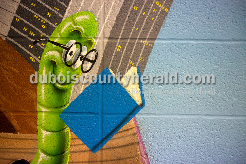 Ariana van den Akker/The Herald<br /> A bookworm graced the walls of the library at Southridge Middle School as part of a new mural on Friday.  The school commissioned the mural, which covers the walls and part of the ceiling, from Orange Moon Art Studio, comprised of Michael and Amanda Smith.