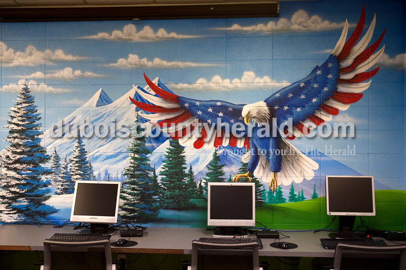 Ariana van den Akker/The Herald<br /> A bald eagle looked like it was about to scoop up a computer in the mural in the library at Southridge Middle School.  The school commissioned the mural, which covers the walls and part of the ceiling, from Orange Moon Art Studio, comprised of Michael and Amanda Smith.  The mural represented the imaginative process that comes from reading.