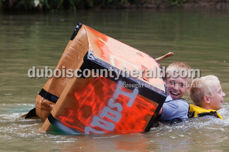 Ariana van den Akker/The Herald<br /> Noah Heim of Jasper 13, and his brother Isaac laughed in the water after their boat sank during the Holy Family School Cardboard Boat Regatta in Jasper on Saturday.