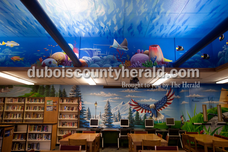 Ariana van den Akker/The Herald<br /> Southridge Middle School commissioned a mural for their library this summer that covers the walls and part of the ceiling, and celebrates the imagination.  The mural was commissioned from Orange Moon Art Studio, comprised of Michael and Amanda Smith.