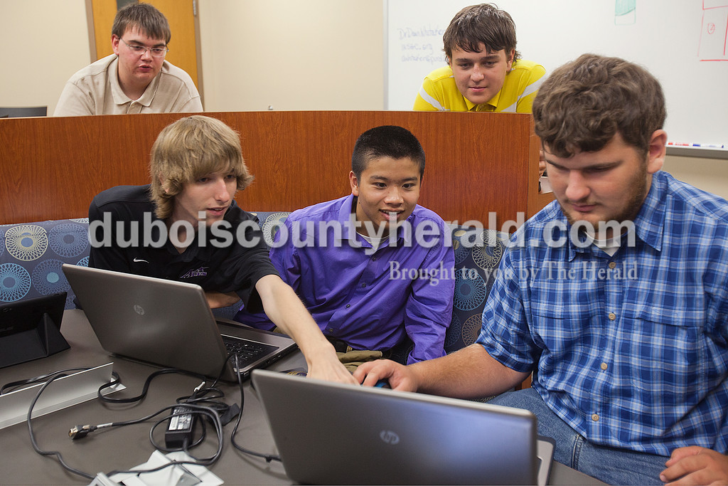 Colton Newton of Winslow, 19, Demetre Young of Petersburg, 19, Steven Lin of Petersburg, 15, Nikolaus Jansen of Petersburg, 16, and Justin Sitzman of Ferdinand, 17, gathered in a collaborating room at VUJC to work on a brochure for their new group Learning Experiences in Applied Fields, L.E.A.F, on Tuesday in Jasper. The group meets at the new manufacturing and technology building every Tuesday and Thursday to take advantage of the facility and work with instructor Ray Niehaus.