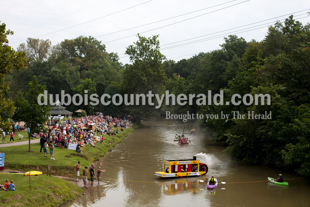 Ariana van den Akker/The Herald<br /> Streicher Construction and Old National Bank's Patoka Queen steamboat rowed to victory during of of the corporate races in the Holy Family School Cardboard Boat Regatta in Jasper on Saturday.