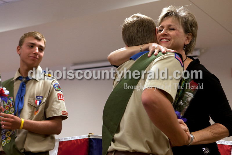 Ariana van den Akker/The Herald<br /> Eli Seng of Jasper, 18, smiled as his mother Sandy hugged his twin Ben after he gave her a rose at their Eagle Scout pinning ceremony at the Arnold F. Habig Community Center on Sunday.  This year, Ben and Eli joined their two older brothers Heath and Jeff in becoming Eagle Scouts.