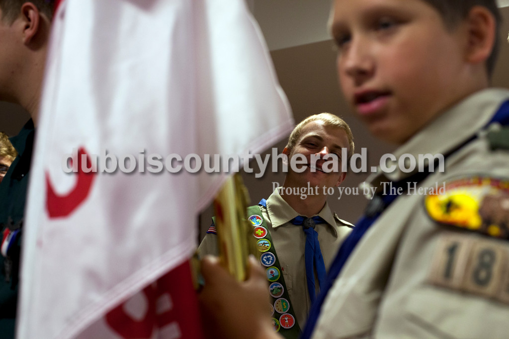 Ariana van den Akker/The Herald<br /> Ben Sang of Jasper, 18, smiled while chatting with fellow boy scouts while LeviHulsman of Jasper, 13, held a flag before Ben and his twin brother Eli's Eagle Scout pinning ceremony at the Arnold F. Habig Community Center on Sunday.  This year, Ben and Eli joined their two older brothers Heath and Jeff in becoming Eagle Scouts.