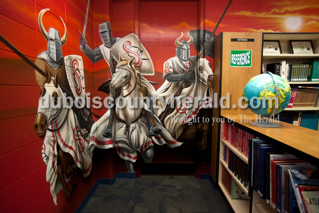 Ariana van den Akker/The Herald<br /> Raiders attack from the corner of the Southridge Middle School library in a new mural.  The school commissioned the mural, which covers the walls and part of the ceiling, from Orange Moon Art Studio, comprised of Michael and Amanda Smith.  The mural represented the imaginative process that comes from reading.
