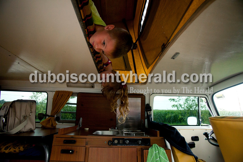 Ariana van den Akker/The Herald<br /> Jameson Fish of Bloomington, 6, and his friend Jasmyn Rogers of Huntingburg, 5, looked down off of the sleeping loft in Jameson's family's Westfalia van at a Volkswagen rally at Huntingburg City Park and hosted by the Southern Indiana Volks Force.