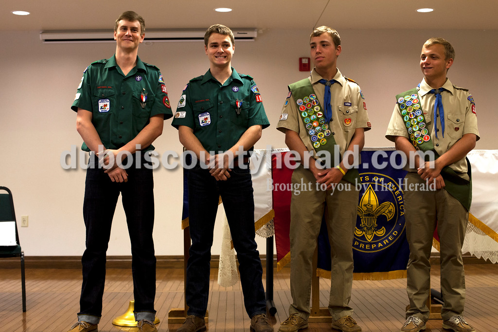 Ariana van den Akker/The Herald<br /> Heath Seng of Jasper, left, and his brothers Jeff, Eli, 18, and Ben, 18, stood in front of the crowd to be recognized during Eli and Ben's Eagle Scout pinning ceremony at the Arnold F. Habig Community Center on Sunday.  The four brothers are all Eagle Scouts.