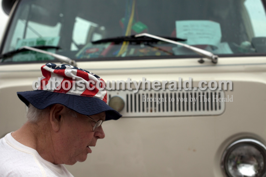 Ariana van den Akker/The Herald<br /> David Eager of Evansville paused while cleaning bugs off of his 1968 Westfalia van at a Volkswagen rally at Huntingburg City Park and hosted by the Southern Indiana Volks Force.