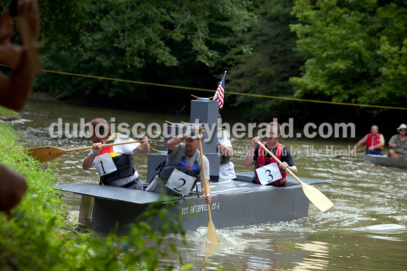 Ariana van den Akker/The Herald<br /> Daniel Buechlein, right, Eric Schum and Daniel Walker, rowing with Uebelhor and Sons, tried to get get their boat back on track during the Holy Family SchoolCardboard Boat Regatta in the Patoka River in Jasper on Saturday.