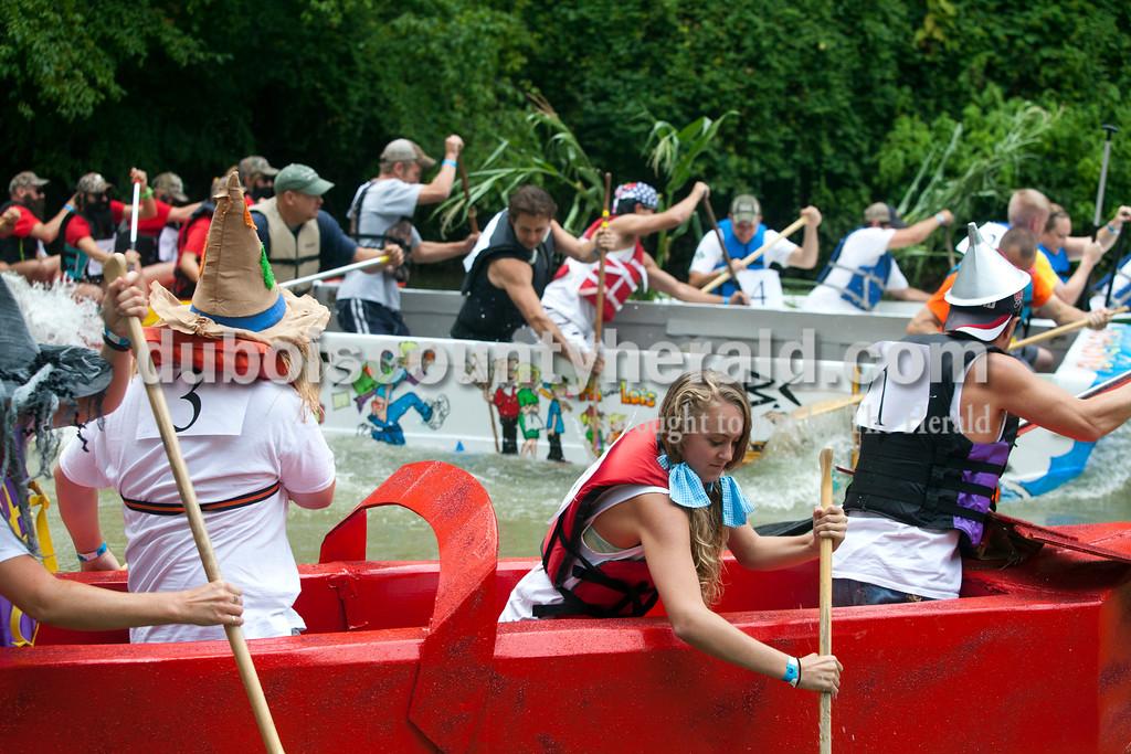 Ariana van den Akker/The Herald<br /> Mara Birrell of Celestine, dressed as Dorothy from the Wizard of Oz, paddles down the Patoka River during Holy Family SchoolCardboard Boat Regatta in Jasper on Saturday.