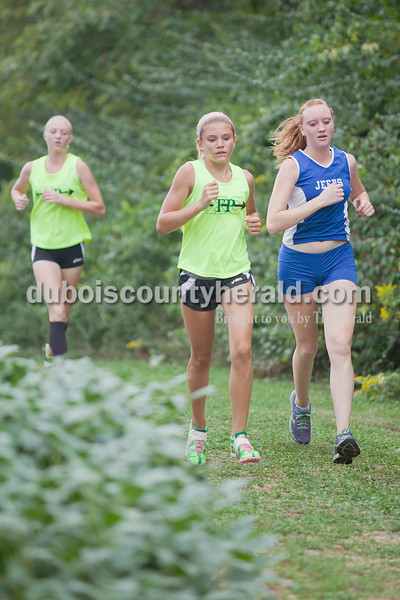 Rachel Mummey/The Herald<br /> Forest Park's Sarah Pund and Northeast Dubois' Lauren Betz ran during the Tri-County Invitational cross country meet at Southridge High School in Huntingburg.