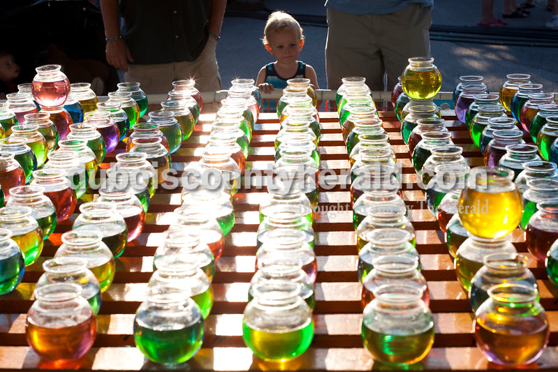 CC Stetter of Chicago, 2, looked at the fish bowls at a carnival game at the Dale Fall Fest on Saturday.  CC's dad Mitch grew up in the area and brought his family down for the festival. Ari van den Akker/The Herald Ariana van den Akker/The Herald