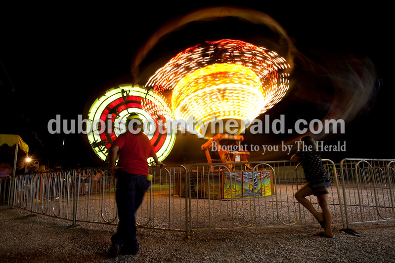 Mickey Sturgeon of Dale watched his son Alex, 6, ride the tornado ride while Destiny Curtis of Santa Claus, 12, waited at the Dale Fall Fest on Saturday. Ariana van den Akker/The Herald