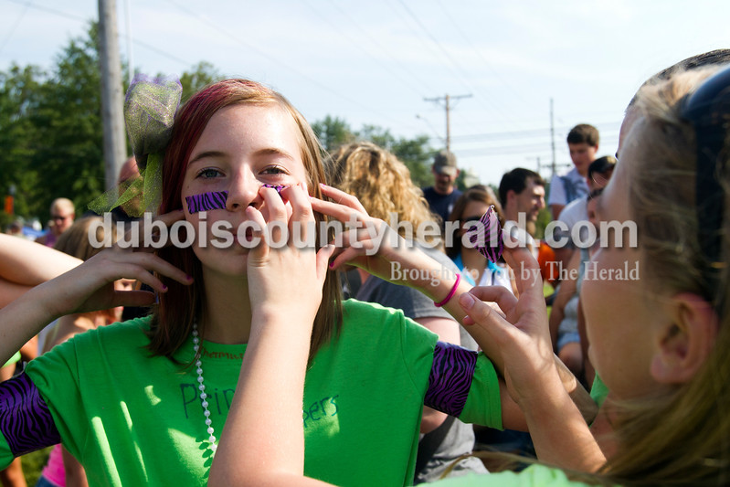 Abby Williams of Dale, 12, received help putting  duct tape on her face in preparation for  hog wrestling at the Dale Fall Fest on Saturday. Ariana van den Akker/The Herald