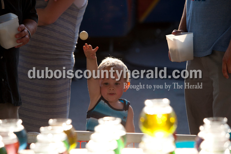 CC Stetter of Chicago, 2, threw a ping pong ball at the fish bowls during the Dale Fall Fest on Saturday.  CC won a fish from the game. Ariana van den Akker/The Herald