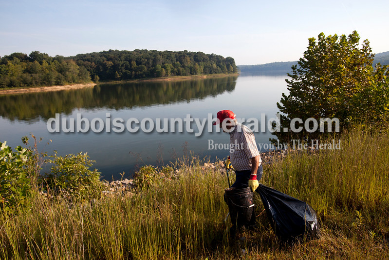 Ariana van den Akker/The Herald<br /> Louie Allstott of Taswell looked for trash to pick up near the South Lick Fork Ramp at Patoka Lake Saturday morning.  Volunteers cleaned up trash at several of the ramps on the lake and then attended a free fish fry at Hoosier Hills Marina.