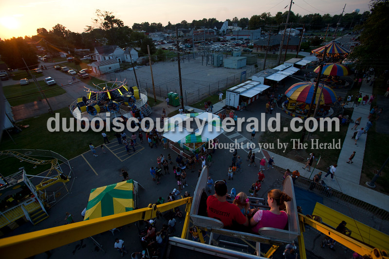 The sun set over the midway at the Dale Fall Fest on Saturday. Ariana van den Akker/The Herald