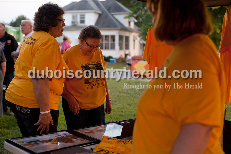 Shirley Beumer of Holland and her friend Delores Roush of Chrisney, both members of the Dale High School class of 1958, looked at old photos from the school, which closed in 1972, at the Dale Fall Fest on Saturday evening.  Ariana van den Akker/The Herald