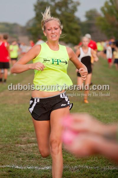 Rachel Mummey/The Herald<br /> Forest Park's Nicole Rahman ran across the finish line during the Tri-County Invitational cross country meet at Southridge High School in Huntingburg.