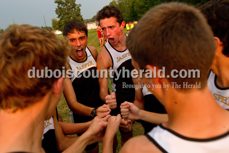 Rachel Mummey/The Herald<br /> Jasper's Donald Bough, left, and Josh Dewitt, right, belted out a quick cheer with teammates before the start of the Tri-County Invitational cross country meet at Southridge High School in Huntingburg.