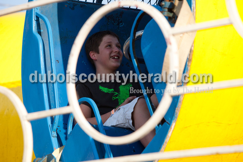 Phoenix Rodgers of Lamar, 11, waited for a ride to start at the Dale Fall Fest on Saturday. Ariana van den Akker/The Herald