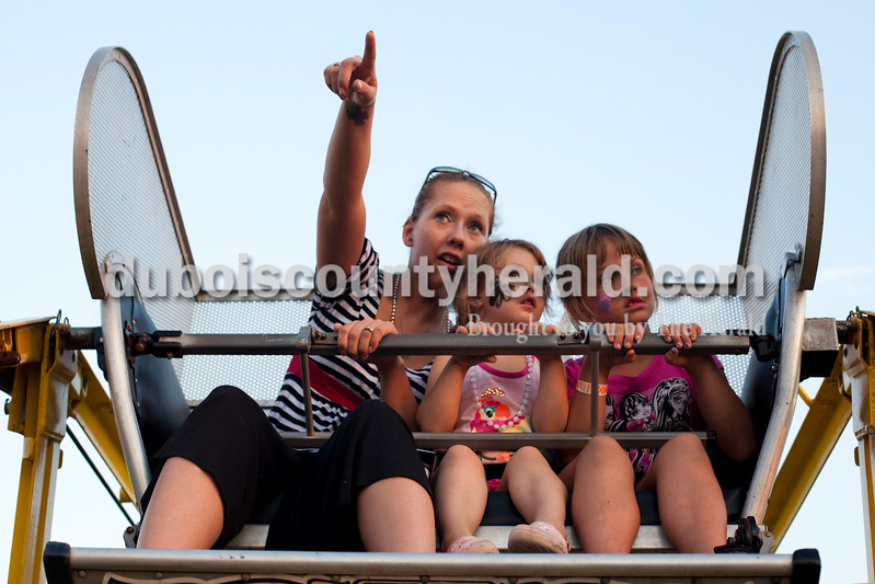Kathy Wright of Evansville, left, pointed out her parents house to her daughter Bella,  4, and her niece Dawna Egbert of Mariah Hill, 7, while on the ferris wheel at the Dale Fall Fest on Saturday. Ariana van den Akker/The Herald