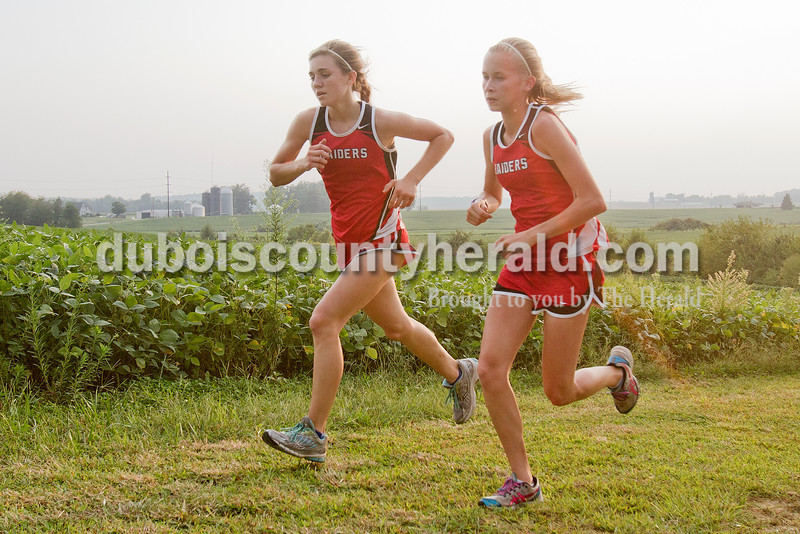 Rachel Mummey/The Herald<br /> Southridge's Lauren Meyer and Casey Lamb ran during the Tri-County Invitational cross country meet at Southridge High School in Huntingburg.