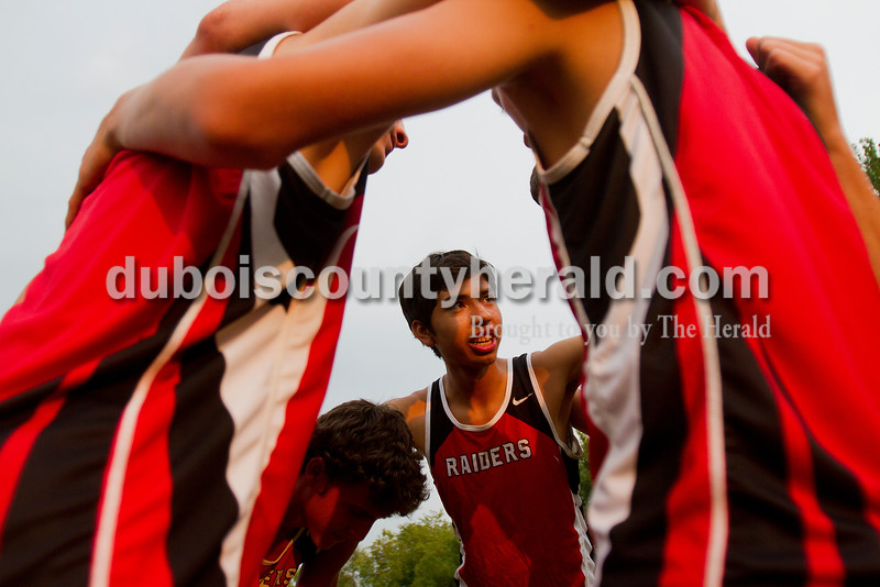 Rachel Mummey/The Herald<br /> Southridge's Louis Dubon talked strategy while huddling with his teammates before the start of the Tri-County Invitational cross country meet at Southridge High School in Huntingburg on Tuesday.
