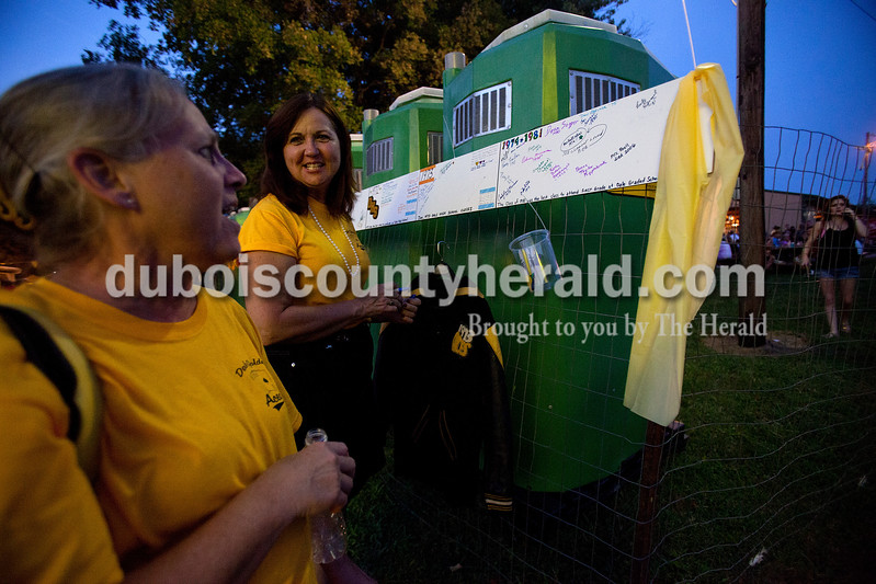Ariana van den Akker/The Herald<br /> Donna (Taylor) Kippenbrock of Dale, left, talked to her elementary school best friend Donna (Mullen) Flamion of Santa Claus while they signed a timeline at the Dale Fall Fest on Saturday evening.  Flamion and a few friends organized an informal reunion for anyone who attended Dale schools, which closed in 1973.