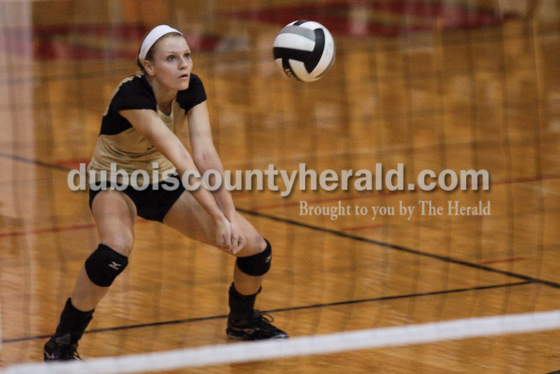 Rachel Mummey/The Herald<br /> Jasper's Michala Flamion dug the ball during Saturday's Class 3A Semi-State competition against Brownstown Central at Edgewood High School in Ellettsville.