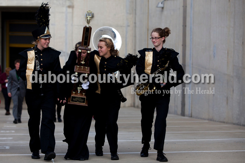 Jasper junior Livia Heller, left, senior drum major Courtney Hayden, junior Maddi Robbling and freshman Claire Schotanus walked back to the bus after the Indiana State School Music Association state marching band finals at Lucas Oil Stadium in Indianapolis on Saturday.  Jasper placed fourth in the Class B competition.  Ariana van den Akker/The Herald