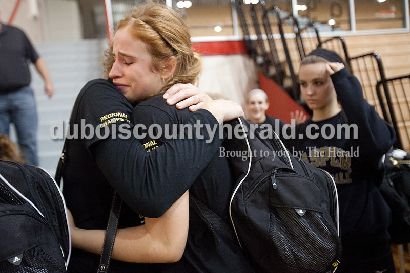 Rachel Mummey/The Herald<br /> Jasper's Tori Sermersheim hugged her mom, Tammy, after the Jasper volleyball team was defeated by Brownstown Central during Saturday's Class 3A Semi-State competition at Edgewood High School in Ellettsville.