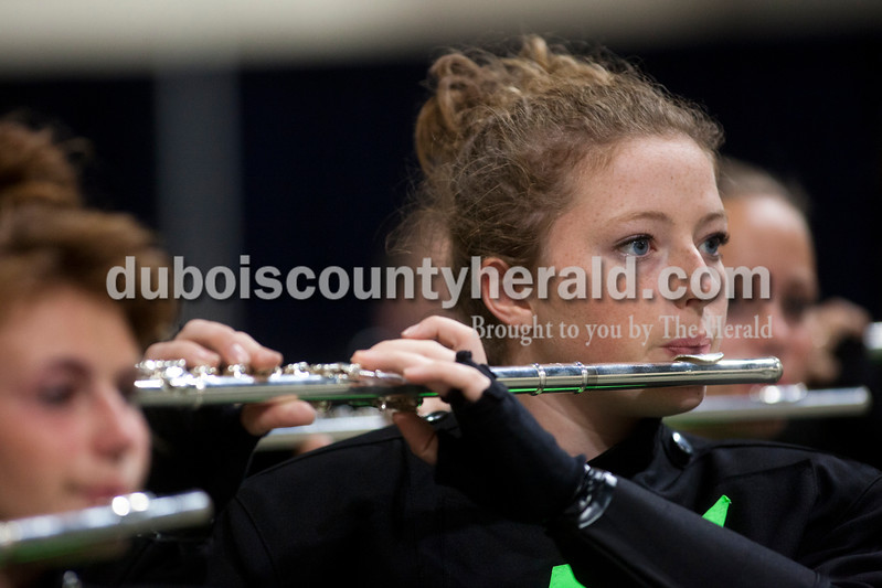 Forest Park sophomore Shelby Olinger played the flute while practing before the Indiana State School Music Association state marching band finals at Lucas Oil Stadium in Indianapolis on Saturday.  The Rangers were awarded first place in Class D for the second year in a row.  Ariana van den Akker/The Herald
