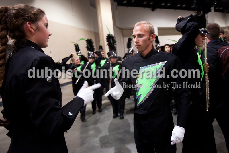 Forest Park band majors sophomore Alyssa Hurm and senior Travis Vonderheide ended their handshake with a point before leaving the practice area at the Indiana State School Music Association state marching band finals at Lucas Oil Stadium in Indianapolis on Saturday.  The Rangers were awarded first place in Class D for the second year in a row.  Ariana van den Akker/The Herald