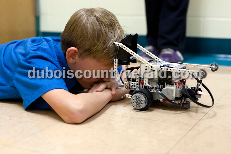 Ariana van den Akker/The Herald<br /> Lincoln Trail Elementary fifth-grader Jackson Foertsch winced as his group's robot hit him in the face as they were testing it Wednesday during a weekly robotics program for fifth and sixth graders in the North Spencer County School Corporation hosted at Heritage Hills Middle School.  During the 12-week program, students learned to build and program lego robots.  Jackson and his group specifically programmed the robot to hit him in the face because they thought it would be funny.