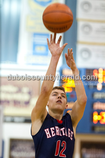 Heritage Hills' Sam Scherry shot a free throw during Tuesday night's game against Northeast Dubois in Dubois.  The Patriots won 74-54.  Ariana van den Akker/The Herald