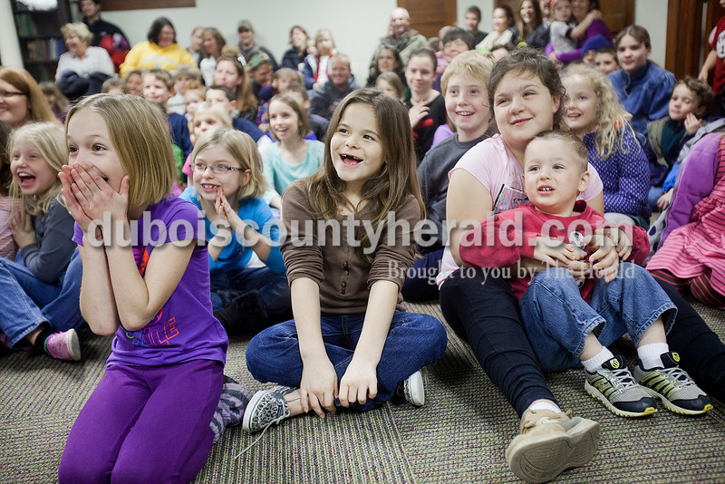 Mackenzie Tobin, 8, from far left, Dacota Meyer, 8, Kylie Merkel, 8, Tehya Neukam, 7, Talon Collier, 10, Decota's sister Lexi, 10, and Beau Larsson, 2, all of Huntingburg and Caroline Buechlein of Jasper, 7, squealed with anticipation as they watched a presentation by the Silly Safari's Indiana Reindeer Reserve based out of Indianapolis at the Huntingburg Public Library on Tuesday. Rachel Mummey/The Herald