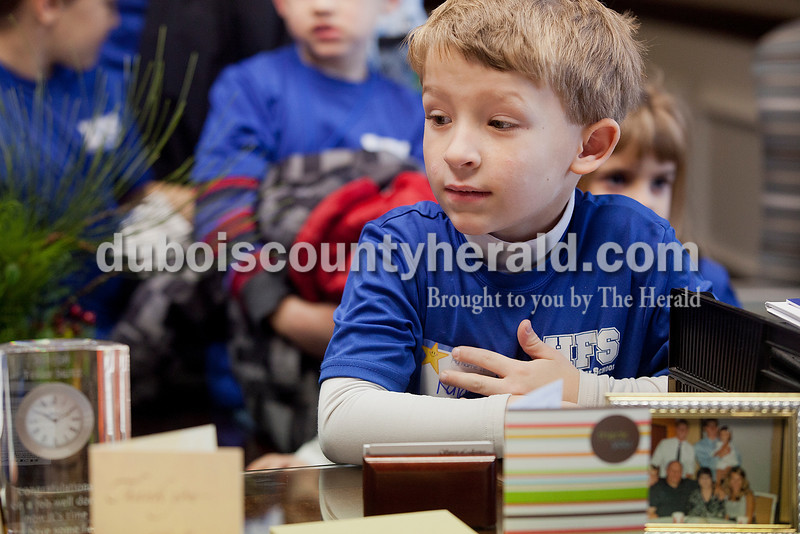 Rachel Mummey/The Herald<br /> Holy Family kindergartener Kaiden Schmidt checked out Mayor Terry Seitz's desk at Jasper City Hall during their Mystery Minute Field Trip on Friday. The group received a tour of City Hall, met Mayor Terry Seitz and sang Christmas songs to city employees.